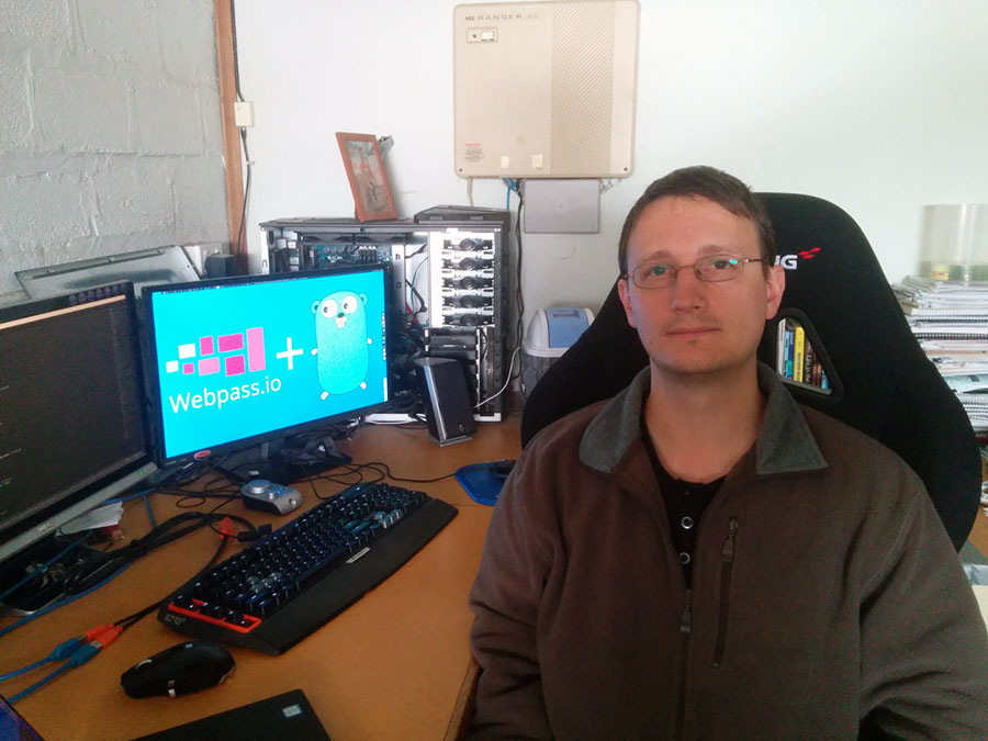 Mark with his desktop computer setup